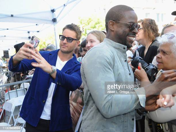 Justin Hartley and Sterling K Brown sign autographs and pose with fans at Mandy Moore's Star Ceremony on the Hollywood Walk of Fame on March 25 2019...