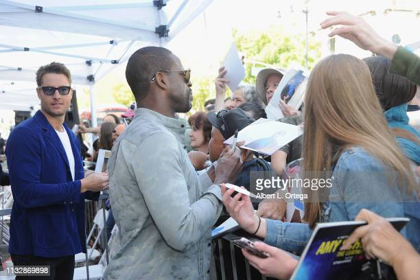 Justin Hartley and Sterling K Brown sign autographs at Mandy Moore's Star Ceremony on the Hollywood Walk of Fame on March 25 2019 in Hollywood...