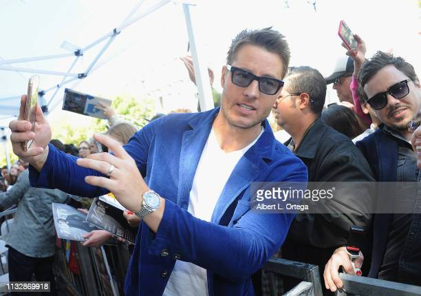 Justin Hartley takes selfies at Mandy Moore's Star Ceremony on the Hollywood Walk of Fame on March 25 2019 in Hollywood California