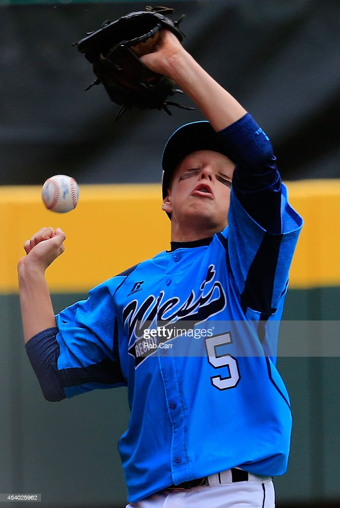 Justin Hausner #5 of of the West Team from Las Vegas, Nevada misses catching a foul ball against the Great Lakes Team from Chicago, Illinois during the United States Championship game of the Little League World Series at Lamade Stadium on August 23, 2014 in South Williamsport, Pennsylvania.