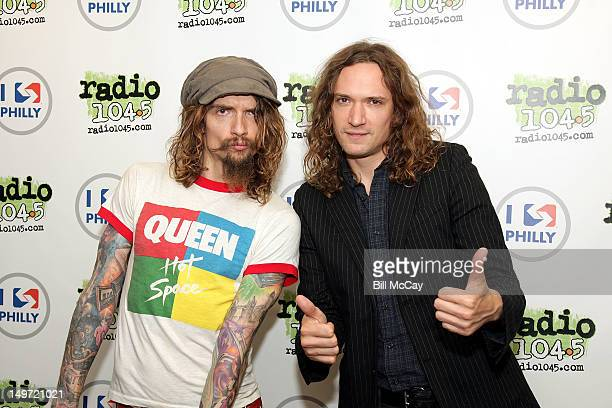 Justin Hawkins and Dan Hawkins from the band The Darkness pose at Radio 1045 iHeartRadio Performance Theater August 2 2012 in Bala Cynwyd Pennsylvania