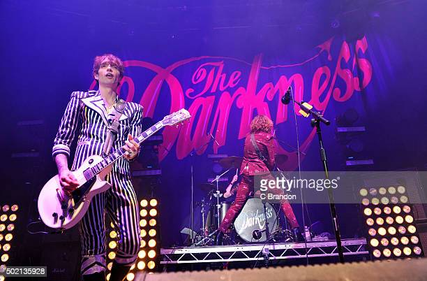 Justin Hawkins and Dan Hawkins of The Darkness perform on stage at The Roundhouse on December 20 2015 in London England