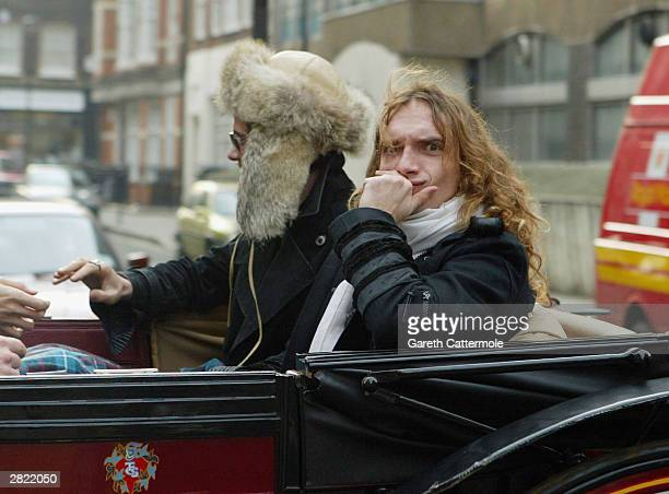 Justin Hawkins and Frankie Poullain of The Darkness leave Radio 1 to promote their new christmas single 'Christmas Time ' on December 19 2003 in...