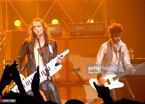 Justin Hawkins and Frankie Poullain of The Darkness perform on stage at Brixton Academy on November 23rd 2004 in London England