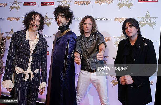 Justin Hawkins Frank Poullain Dan Hawkins and Ed Graham of The Darkness attend the Classic Rock Roll of Honour at The Roundhouse on November 14 2013...