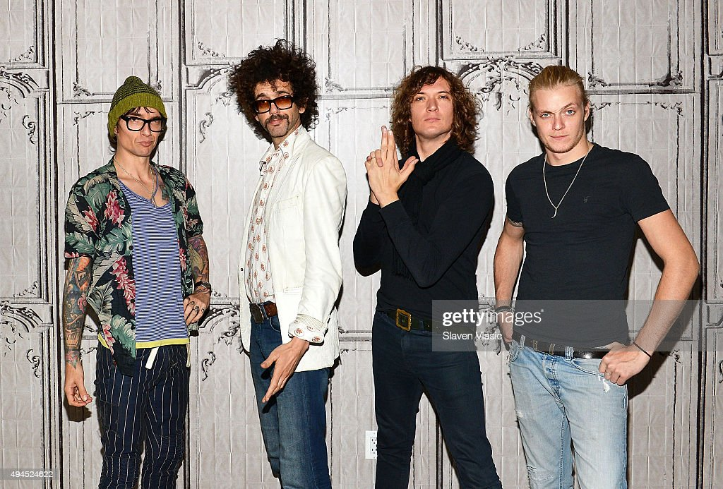 Justin Hawkins, Frankie Poullain, Dan Hawkins and Rufus Taylor of the band 'The Darkness' visit AOL BUILD to discuss their new album 'Last Of Our Kind' at AOL Studios In New York on October 27, 2015 in New York City.
