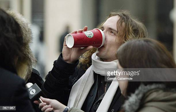 Justin Hawkins of The Darkness leaves Radio 1 to promote their new christmas single 'Christmas Time ' on December 19 2003 in Central London