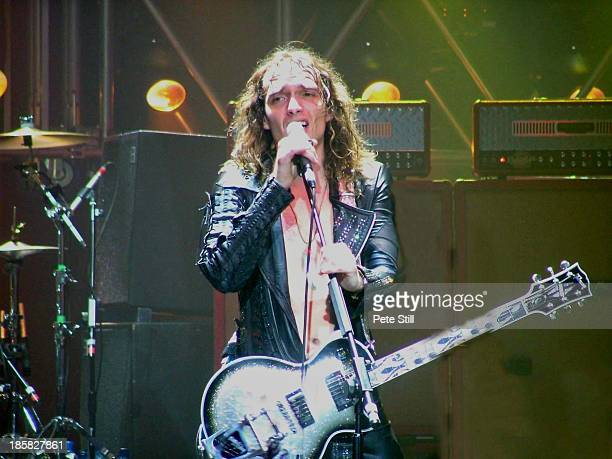 Justin Hawkins of The Darkness performs on stage at Brixton Academy on November 23rd 2004 in London England