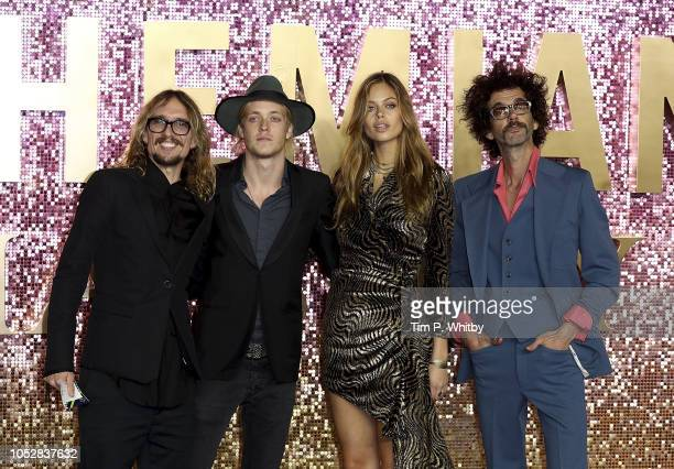 Justin Hawkins Rufus Tiger Taylor and Frankie Poullain of the Darkness with model Jessica Clarke attend the World Premiere of 'Bohemian Rhapsody' at...
