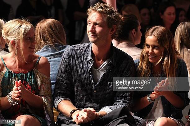 Justin Hemmes and Natalie Mark watch the Alex Perry catwalk during Rosemount Australian Fashion Week Spring/Summer 2011/12 at Overseas Passenger...