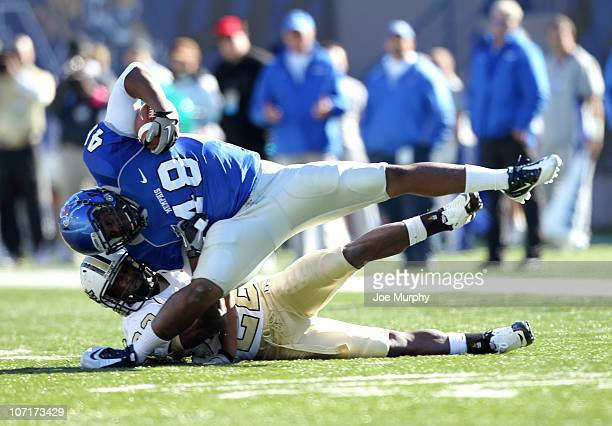 Justin Henderson of the Memphis Tigers is tackled by Emery Allen of the Central Florida Knights on November 27 2010 at Liberty Bowl Memorial Stadium...