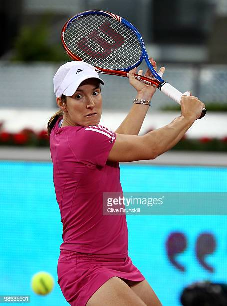 Justin Henin of Belgium plays a backhand against Aravane Rezai of France in their first round match during the Mutua Madrilena Madrid Open tennis...