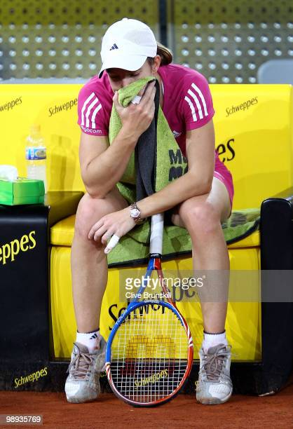 Justin Henin of Belgium shows her dejection against Aravane Rezai of France in their first round match during the Mutua Madrilena Madrid Open tennis...