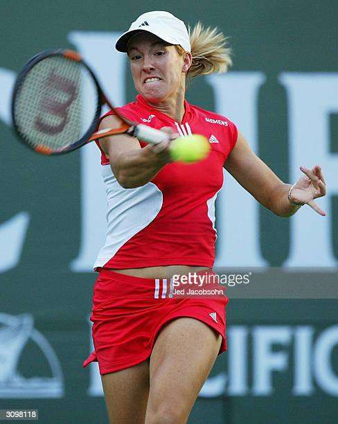 Justin HeninHardenne of Belgium returns a shot against Marta Marrero of Spain at the Pacific Life Open March 15 2004 at the Indian Wells Tennis...