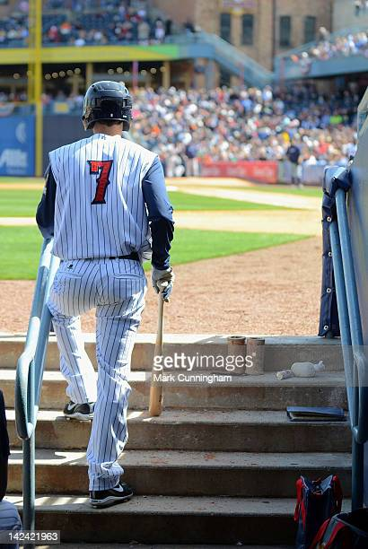 Justin Henry of the Toledo Mud Hens looks on from the dugout steps while waiting to bat during the exhibition game against the Detroit Tigers at...