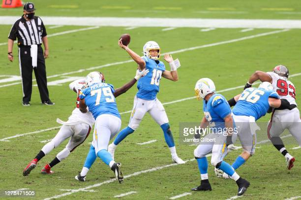 Justin Herbert of the Los Angeles Chargers throws a pass during the fourth quarter of a game against the Tampa Bay Buccaneers at Raymond James...