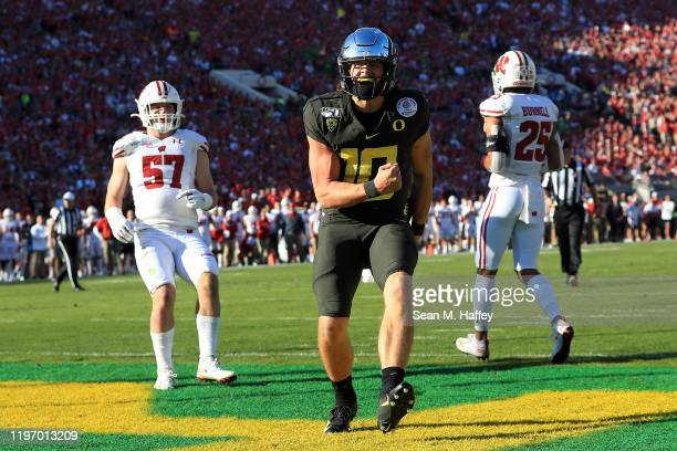 Justin Herbert of the Oregon Ducks celebrates after scoring a four yard touchdown against the Wisconsin Badgers during the first quarter in the Rose...