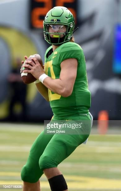 Justin Herbert of the Oregon Ducks gets set to pass the ball during the first half of the game against the Portland State Vikings at Autzen Stadium...