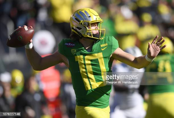 Justin Herbert of the Oregon Ducks looks to pass against the Michigan State Spartans during the first half of the Redbox Bowl at Levi's Stadium on...