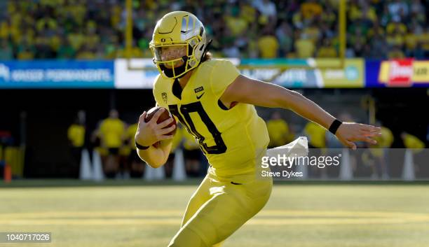 Justin Herbert of the Oregon Ducks runs with the ball during the second half of the game against Bowling Green Falcons at Autzen Stadium on September...