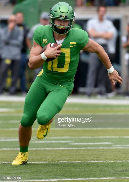 Justin Herbert of the Oregon Ducks runs with the ball during the first half of the game against the Portland State Vikings at Autzen Stadium on...