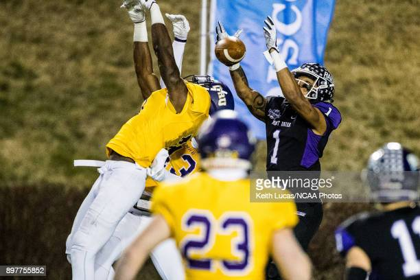 Justin Hill of the University of Mount Union elevates over Reginald Cole and Jefferson Fritz of the University of Mary HardinBaylor for a touchdown...