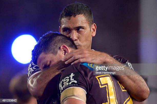 Justin Hodges consoles Matt Gillett of the Broncos after defeat during the 2015 NRL Grand Final match between the Brisbane Broncos and the North...