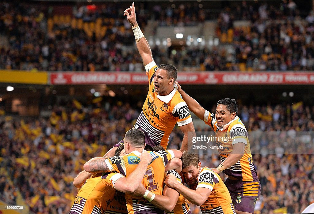 Justin Hodges of the Broncos and team mates are seen celebrating a try by Jack Reed during the NRL First Preliminary Final match between the Brisbane Broncos and the Sydney Roosters at Suncorp Stadium on September 25, 2015 in Brisbane, Australia.