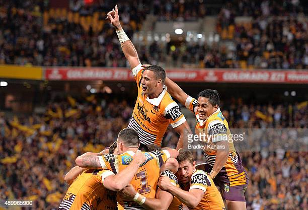Justin Hodges of the Broncos and team mates celebrate a try by Jack Reed during the NRL First Preliminary Final match between the Brisbane Broncos...