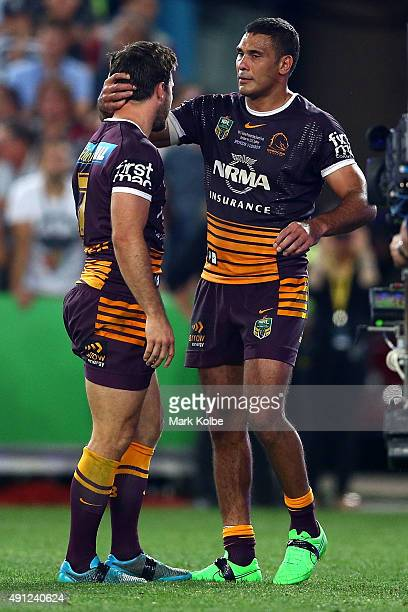 Justin Hodges of the Broncos consoles Ben Hunt of the Broncos after the 2015 NRL Grand Final match between the Brisbane Broncos and the North...