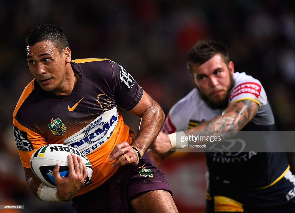 Justin Hodges of the Broncos gets past Kyle Feldt of the Cowboys the NRL 1st Elimination Final match between the North Queensland Cowboys and the Brisbane Broncos at 1300SMILES Stadium on September 13, 2014 in Townsville, Australia.