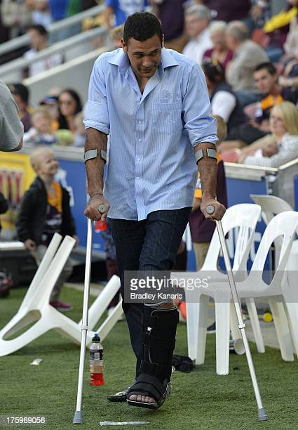 Justin Hodges of the Broncos is seen in crutches after injuring his leg during the round 22 NRL match between the Brisbane Broncos and the St George...