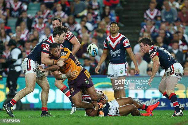 Justin Hodges of the Broncos is tackled by Rooster's Aidan Guerra and Michael Jennings during the round 24 match between Sydney Roosters and Brisbane...