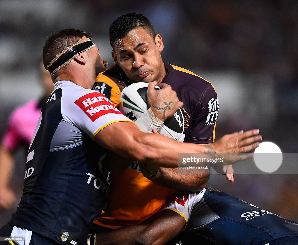 Justin Hodges of the Broncos is tackled by Tariq Sims of the Cowboys during the NRL 1st Elimination Final match between the North Queensland Cowboys and the Brisbane Broncos at 1300SMILES Stadium on September 13, 2014 in Townsville, Australia.
