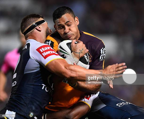 Justin Hodges of the Broncos is tackled by Tariq Sims of the Cowboys during the NRL 1st Elimination Final match between the North Queensland Cowboys...