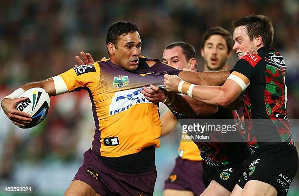 Justin Hodges of the Broncos is tackled during the round 23 NRL match between the South Sydney Rabbitohs and the Brisbane Broncos at ANZ Stadium on...