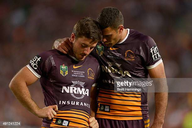 Justin Hodges of the Broncos reacts with Ben Hunt of the Broncos after defeat during the 2015 NRL Grand Final match between the Brisbane Broncos and...