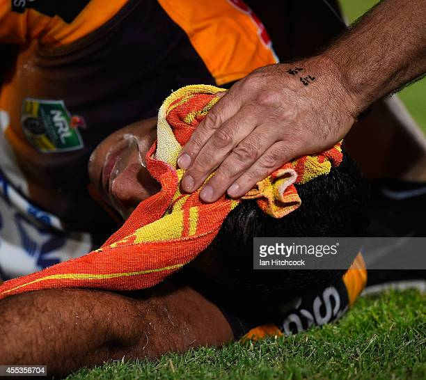 Justin Hodges of the Broncos recieves treatment after being injured during the NRL 1st Elimination Final match between the North Queensland Cowboys...