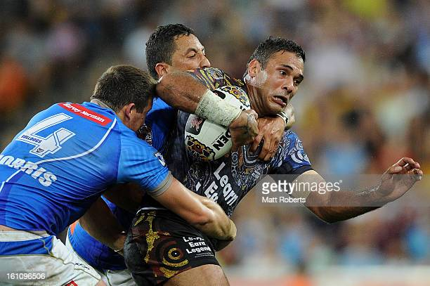 Justin Hodges of the Indigenous All Stars is tackled during the NRL All Stars Game between the Indigenous All Stars and the NRL All Stars at Suncorp...