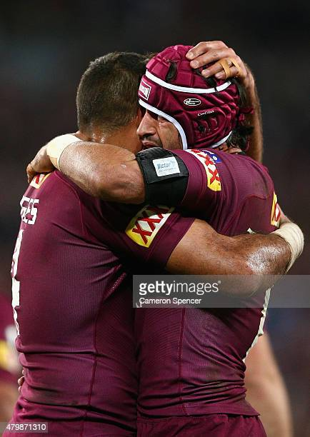 Justin Hodges of the Maroons and Johnathan Thurston of the Maroons embrace after a try by team mate Greg Inglis during game three of the State of...