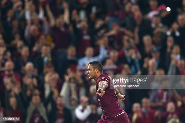Justin Hodges of the Maroons celebrates kicking a conversion during game three of the State of Origin series between the Queensland Maroons and the...
