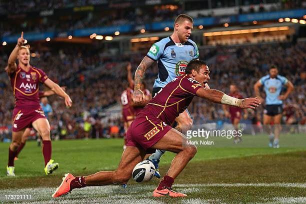 Justin Hodges of the Maroons celebrates scoring a try during game three of the ARL State of Origin series between the New South Wales Blues and the...