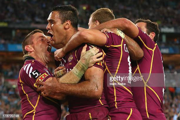 Justin Hodges of the Maroons celebrates with his team mates after scoring a try during game three of the ARL State of Origin series between the New...