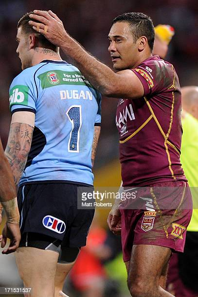 Justin Hodges of the Maroons pats Josh Dugan of the Blues on the head during game two of the ARL State of Origin series between the Queensland...