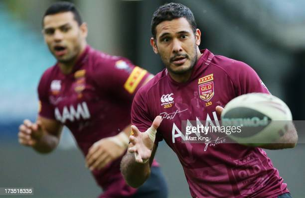 Justin Hodges takes a pass during a Queensland Maroons State of Origin training session at ANZ Stadium on July 16 2013 in Sydney Australia
