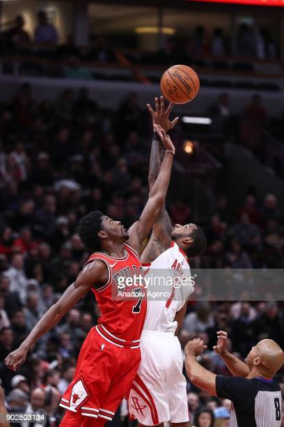 Justin Holiday of Chicago Bulls in action against Trevor Ariza of Houston Rockets during the NBA game between Chicago Bulls and Houston Rockets on...