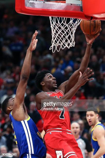 Justin Holiday of Chicago Bulls in action during the NBA basketball match between Chicago Bulls and Golden State Warriors at the United Center in...
