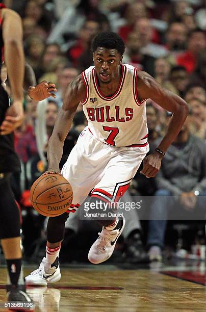 Justin Holiday of the Chicago Bulls brings the ball up the court against the Portland Trail Blazers at the United Center on February 27 2016 in...