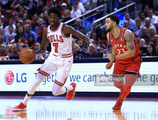 Justin Holiday of the Chicago Bulls dribbles the ball as Fred VanVleet of the Toronto Raptors defends during the first half of an NBA game at Air...