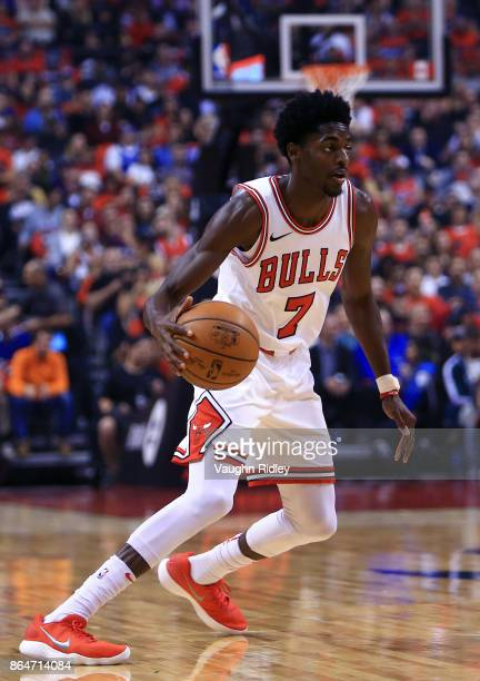 Justin Holiday of the Chicago Bulls dribbles the ball during to the first half of an NBA game against the Toronto Raptors at Air Canada Centre on...